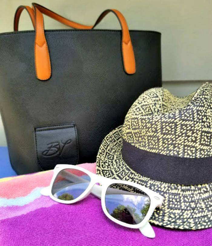 List Of Essentials For A Perfect Day At The Beach hat and gkasses